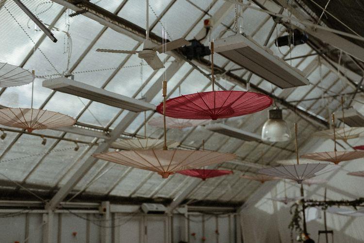 Parasol Ceiling Decor   Orange, White & Green Boho Wedding at Clifton Nurseries London    Olivia & Dan Photography