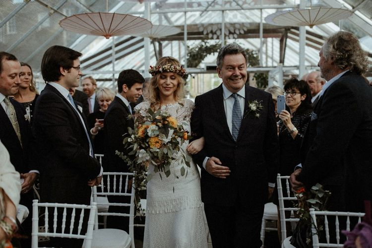 Wedding Ceremony   Boho Bride in Lace Sally Lacock Gown with Flower Crown   Father of the Bride  in Suit Supply Suit    Orange, White & Green Boho Wedding at Clifton Nurseries London    Olivia & Dan Photography