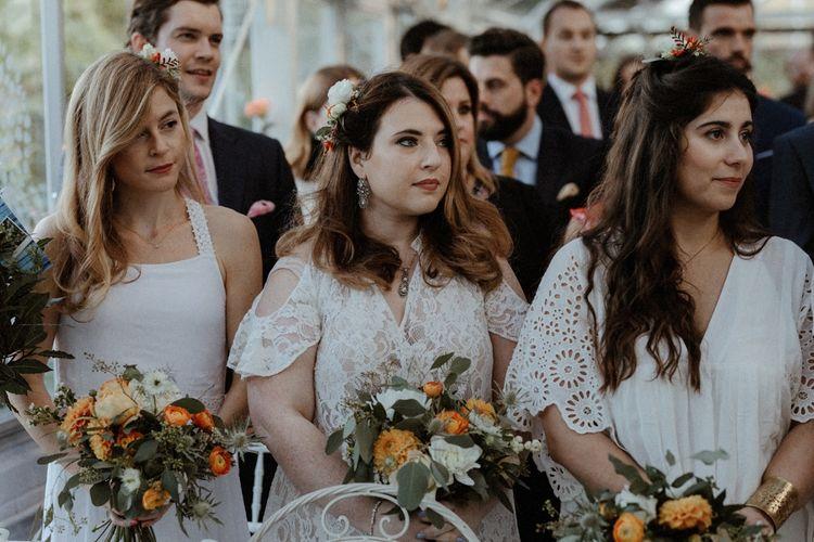 Bridesmaids in Different White Dresses    Orange, White & Green Boho Wedding at Clifton Nurseries London    Olivia & Dan Photography
