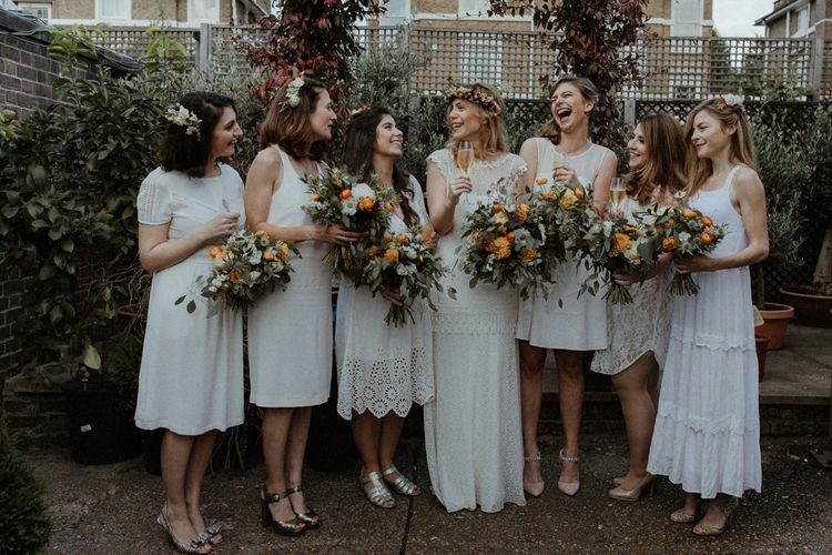 Bridesmaids in Different White Dresses   Boho Bride in Lace Sally Lacock Gown with Flower Crown   Orange, White & Green Boho Wedding at Clifton Nurseries London    Olivia & Dan Photography