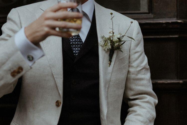 Groom in Beige Suit Supply Suit   Orange, White & Green Boho Wedding at Clifton Nurseries London    Olivia & Dan Photography