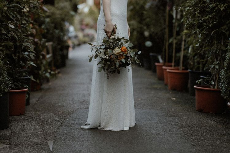 Boho Bride in Lace Sally Lacock Gown with Flower Crown & Bouquet   Orange, White & Green Boho Wedding at Clifton Nurseries London    Olivia & Dan Photography
