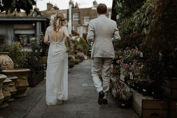 Boho Bride in Lace Sally Lacock Gown with Flower Crown   Groom in Beige Suit Supply Suit    Orange, White & Green Boho Wedding at Clifton Nurseries London    Olivia & Dan Photography