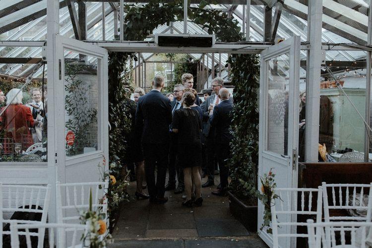 Glasshouse Wedding Venue   Orange, White & Green Boho Wedding at Clifton Nurseries London    Olivia & Dan Photography