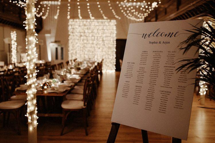 Table Plan and Fairy Light Reception   Orange, White & Green Boho Wedding at Clifton Nurseries London    Olivia & Dan Photography