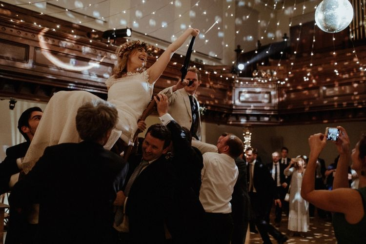 Evening Reception Dancing   Boho Bride in Lace Sally Lacock Gown with Flower Crown   Groom in Beige Suit Supply Suit    Orange, White & Green Boho Wedding at Clifton Nurseries London    Olivia & Dan Photography