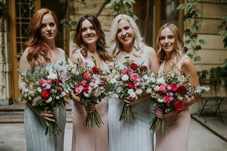 Bridesmaids in Blue Drop Waist Dresses with Spaghetti Straps and Beading | Bridesmaids in Pink V-Neck Dresses | Wedding Bouquets with Pink, Red and White Flowers and Foliage | Budapest Wedding with Giant Bridal Bouquet, Tuk Tuks and Cadillac | Jágity Fanni Fotográfus