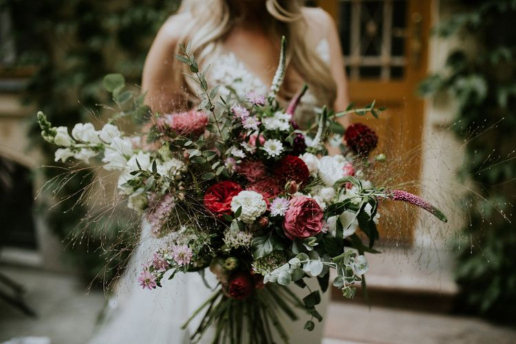 Bride in Lila Gown by Alexandra Grecco with Fitted Silk Crepe Skirt and Sheer Italian Tulle Bodice Covered in Floral Lace Applique | Oversized  Bouquet with Pink, Red and White Flowers and Foliage | Budapest Wedding with Giant Bridal Bouquet, Tuk Tuks and Cadillac | Jágity Fanni Fotográfus