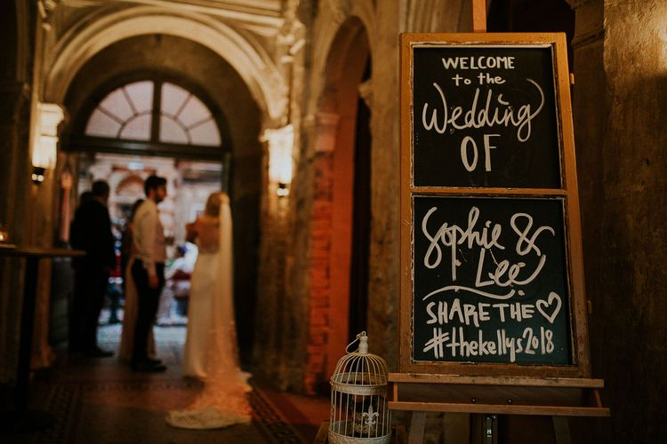 Chalkboard Welcome Sign | Budapest Wedding with Giant Bridal Bouquet, Tuk Tuks and Cadillac | Jágity Fanni Fotográfus