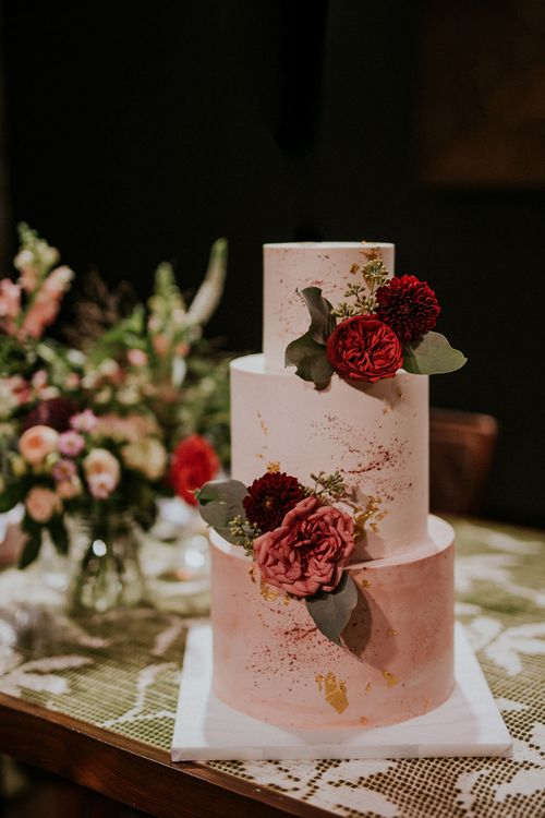 Three-Tier Wedding Cake with Pink Icing, Gold Leaf and Pink Flowers | Budapest Wedding with Giant Bridal Bouquet, Tuk Tuks and Cadillac | Jágity Fanni Fotográfus