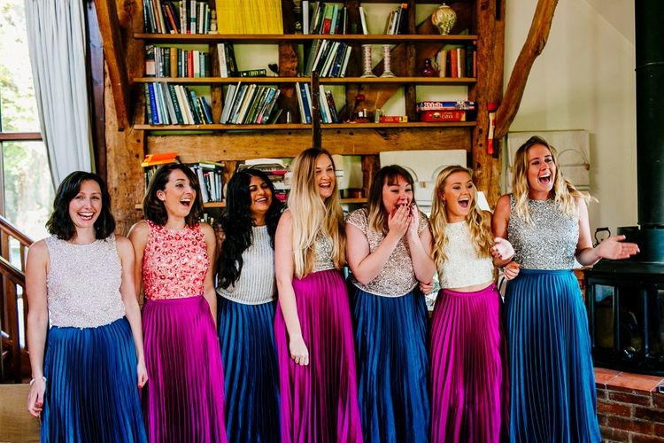 Bridesmaids in Jewel Coloured Skirts & Sequin Top Separates | Colourful Alternative Winter Wedding at Upwaltham Barns, Sussex | Epic Love Story Photography