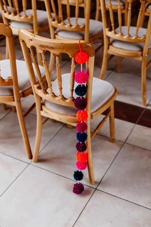 Pom Pom Chair Back Decor | Colourful Alternative Winter Wedding at Upwaltham Barns, Sussex | Epic Love Story Photography