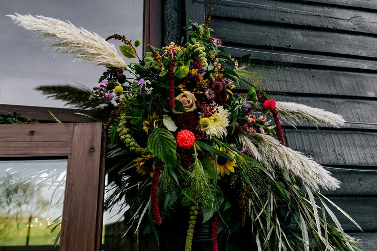 Wild Wedding Flowers | Colourful Alternative Winter Wedding at Upwaltham Barns, Sussex | Epic Love Story Photography