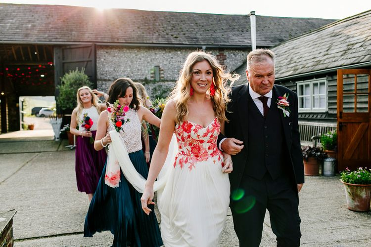Bridal Entrance in Red & White Joanne Fleming Design Wedding Dress | Colourful Alternative Winter Wedding at Upwaltham Barns, Sussex | Epic Love Story Photography