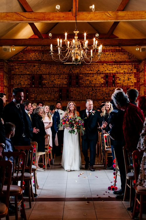 Wedding Ceremony | Bridal Entrance in Red & White Joanne Fleming Design Wedding Dress | Colourful Alternative Winter Wedding at Upwaltham Barns, Sussex | Epic Love Story Photography