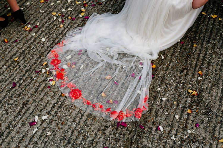 Confetti Moment |  Bride in Red & White Joanne Fleming Design Wedding Dress | Colourful Alternative Winter Wedding at Upwaltham Barns, Sussex | Epic Love Story Photography