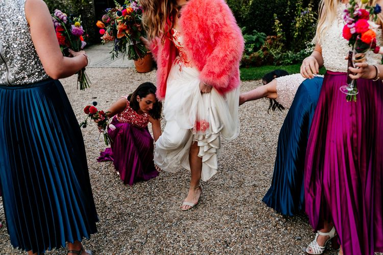 Bride in Red & White Joanne Fleming Design Wedding Dress | Pink Faux Fur Jacket | Bridesmaids in Jewel Coloured Skirts & Sequin Top Separates | Colourful Alternative Winter Wedding at Upwaltham Barns, Sussex | Epic Love Story Photography