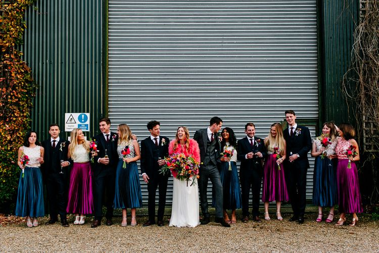Wedding Party | Bride in Red & White Joanne Fleming Design Wedding Dress | Pink Faux Fur Jacket | Bridesmaids in Jewel Coloured Skirts & Sequin Top Separates | Groomsmen in Suit Supply | Colourful Alternative Winter Wedding at Upwaltham Barns, Sussex | Epic Love Story Photography