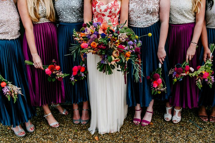 Oversized Bridal Bouquets | Bride in Red & White Joanne Fleming Design Wedding Dress | Bridesmaids in Jewel Coloured Skirts & Sequin Top Separates | Colourful Alternative Winter Wedding at Upwaltham Barns, Sussex | Epic Love Story Photography