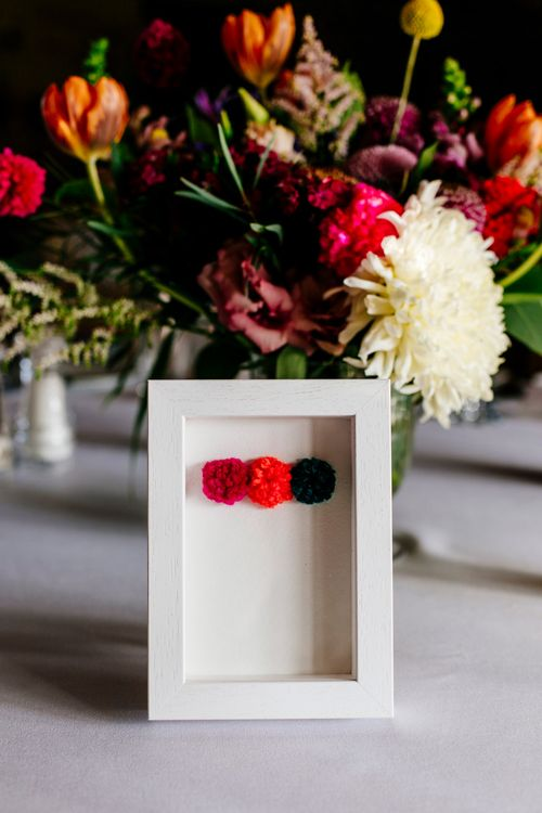 Pom Pom Table Number Sign | Colourful Alternative Winter Wedding at Upwaltham Barns, Sussex | Epic Love Story Photography