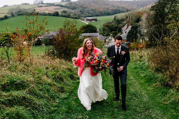 Bride in Red & White Joanne Fleming Design Wedding Dress | Groom in Suit Supply Suit | Colourful Alternative Winter Wedding at Upwaltham Barns, Sussex | Epic Love Story Photography