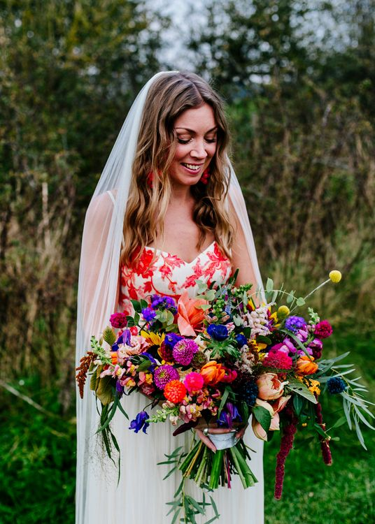 Bride in Red & White Joanne Fleming Design Wedding Dress | Colourful Alternative Winter Wedding at Upwaltham Barns, Sussex | Epic Love Story Photography
