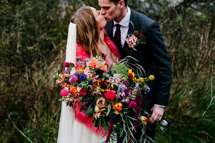 Oversized Bright Bouquets | Bride in Red & White Joanne Fleming Design Wedding Dress | Groom in Suit Supply Suit | Colourful Alternative Winter Wedding at Upwaltham Barns, Sussex | Epic Love Story Photography