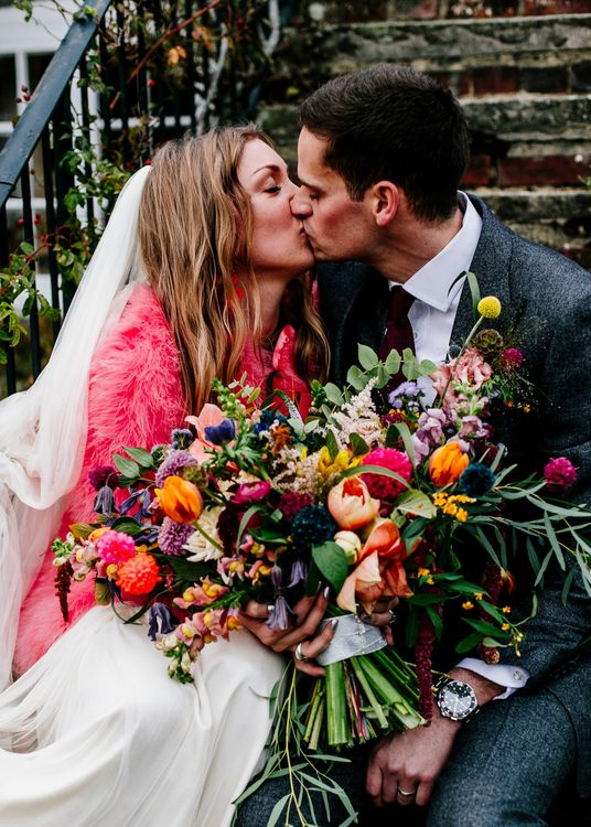 Oversized Colourful Bouquet | Bride in Red & White Joanne Fleming Design Wedding Dress | Groom in Suit Supply Suit | Colourful Alternative Winter Wedding at Upwaltham Barns, Sussex | Epic Love Story Photography