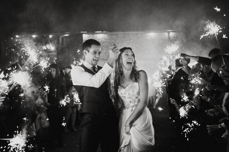 Sparkler Moment | Bride in Red & White Joanne Fleming Design Wedding Dress | Groom in Suit Supply Suit | Colourful Alternative Winter Wedding at Upwaltham Barns, Sussex | Epic Love Story Photography