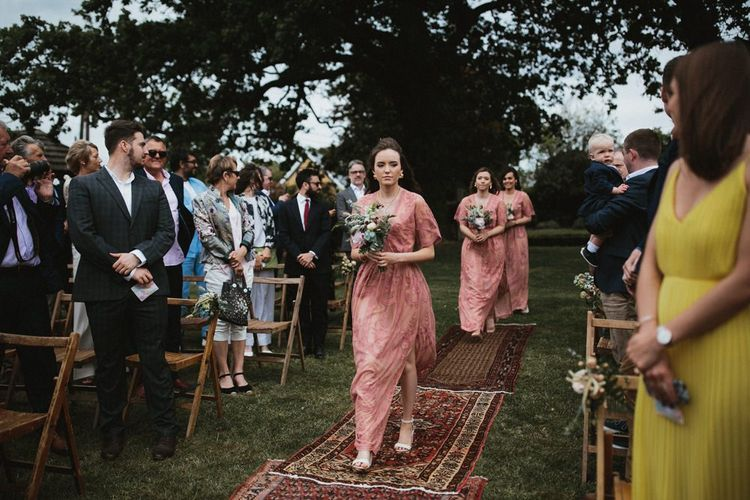 Bridesmaids In Pink Dresses Walking Down the Aisle