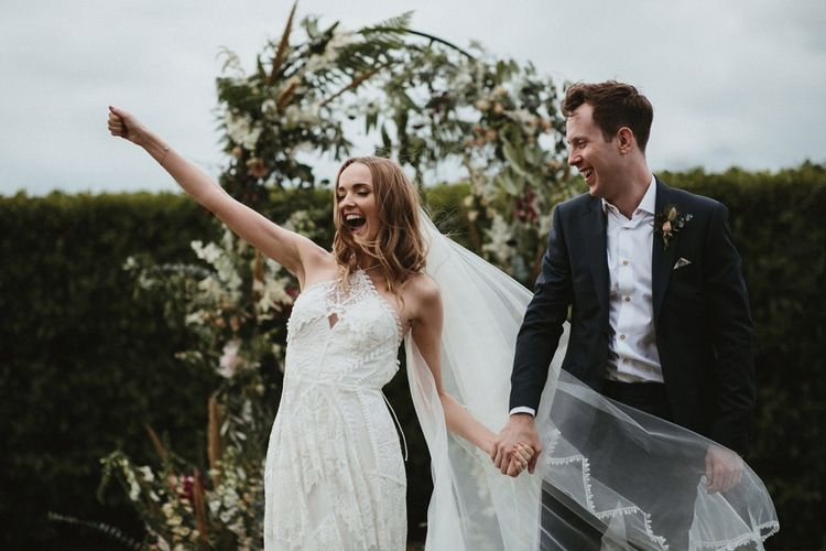 Bride and Groom Celebrate at the Outdoor Wedding Ceremony