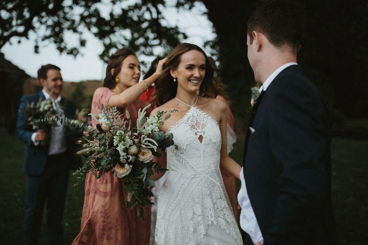 Bride In Lace Halterneck Wedding Dress