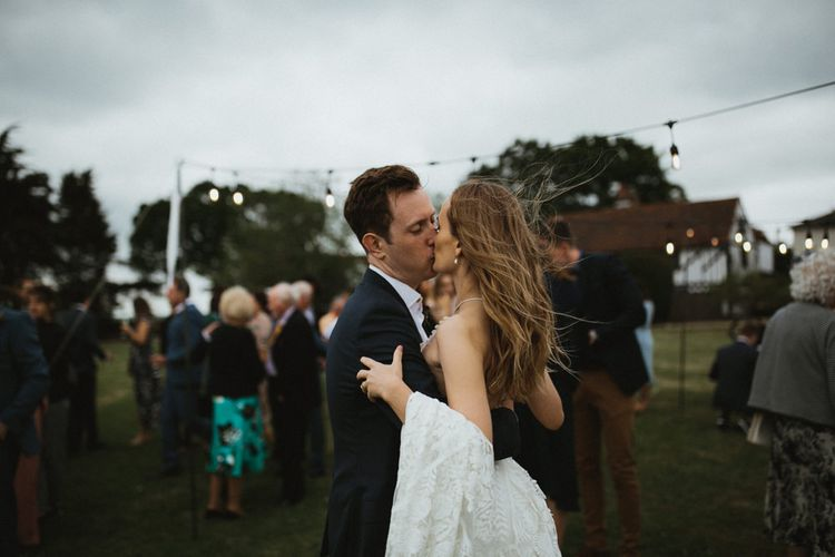 Bride and Groom Kissing After the Wedding Ceremony