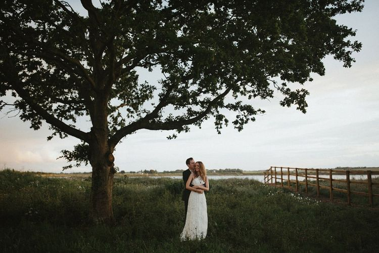 Bride and Groom Portrait Under a Tree