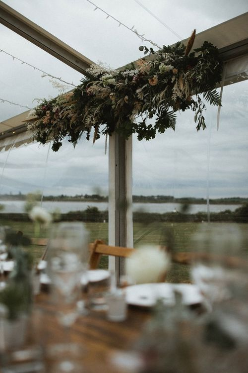 Top Table Wedding Flowers in Clear Span Marquee