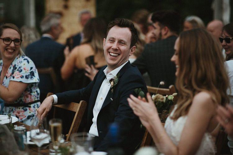 Groom Enjoys Wedding Speeches in Clear Span Marquee Reception