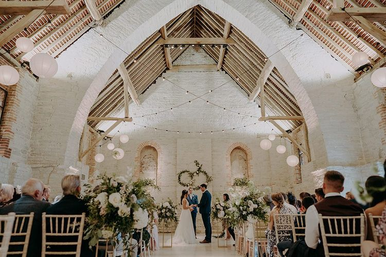 Tithe Barn Petersfield wedding venue with festoon lighting