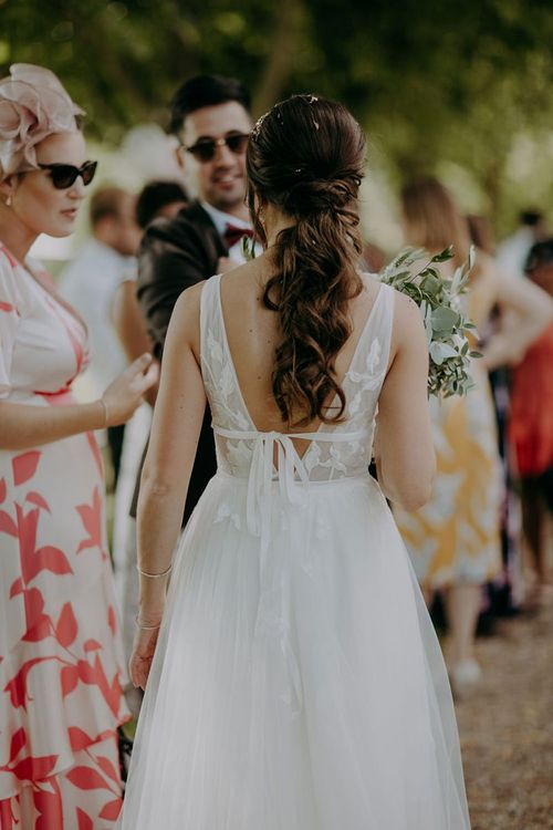 Willowby by Watters wedding dress with ponytail