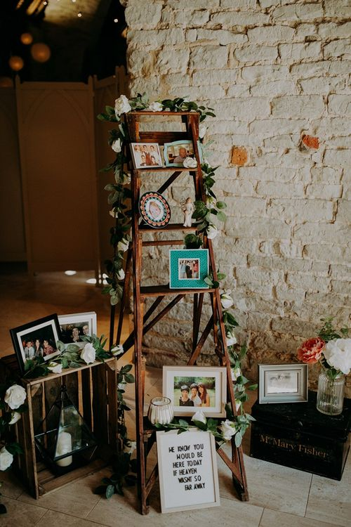 Rustic wedding decor with photo step ladder