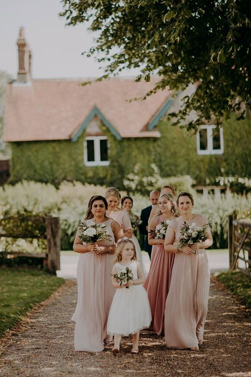 Blush bridesmaid dresses for rustic barn wedding