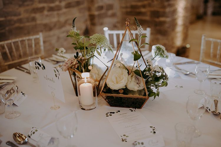 Wedding table decor with flowers and candles