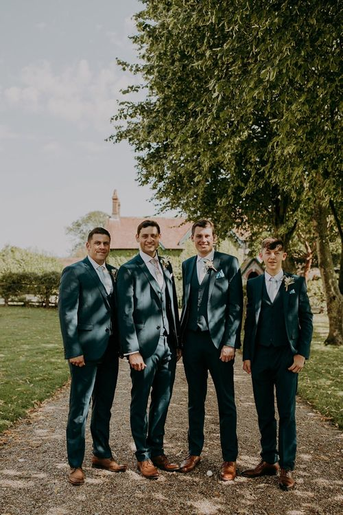 Groomsmen in matching wedding suits at Tithe Barn Petersfield wedding
