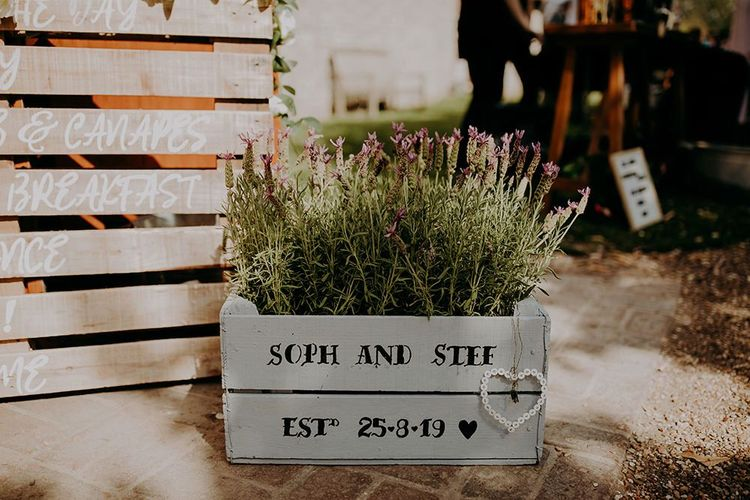Personalised flower boxes for rustic barn wedding at Tithe Barn Petersfield