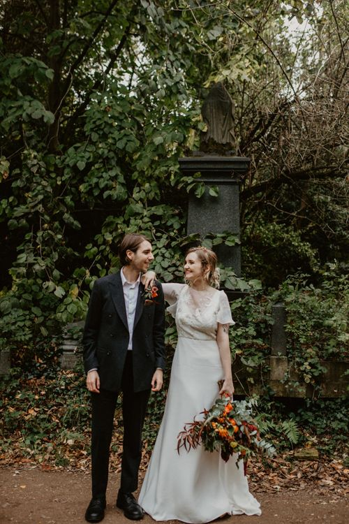 Bride in Story of My Dress Gown and Groom in  Black Suit