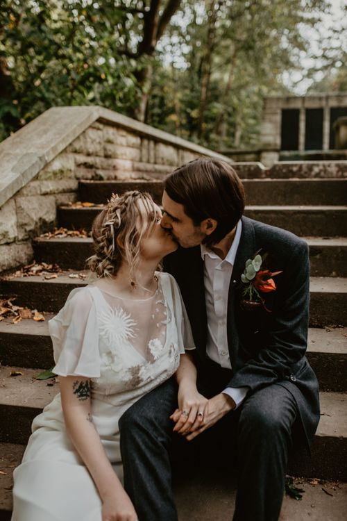 Bride and Groom Kissing on the Steps