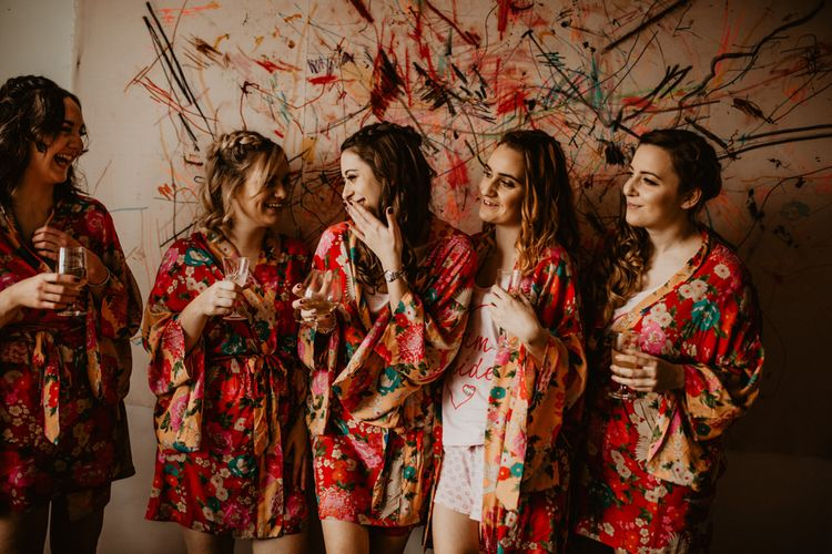 Wedding Morning Bridal Party Preparations in Matching Floral Getting Robes