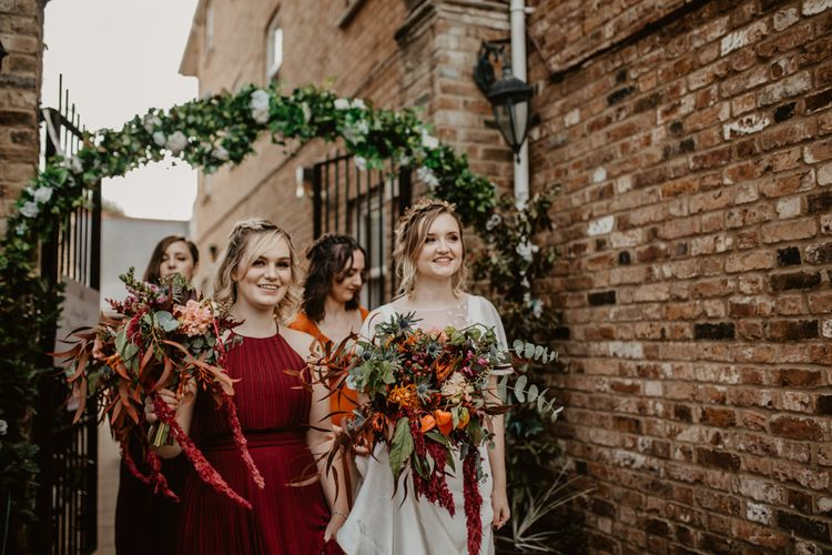Bride and Bridesmaids with Large Bouquets with Cascading Flowers