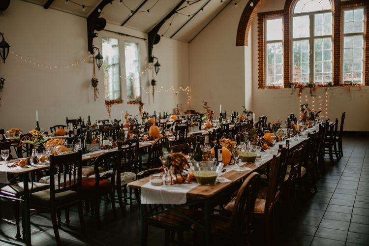 Autumnal Wedding Reception Decor with Fairy Lights and Pumpkins