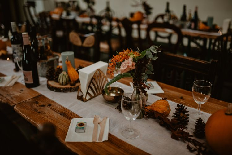 Wedding Table Centrepiece with Miniature Pumpkins, Pinecones and Tree Slices