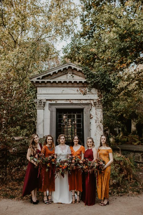 Bridesmaids in Burnt Orange and Deep Red Dresses